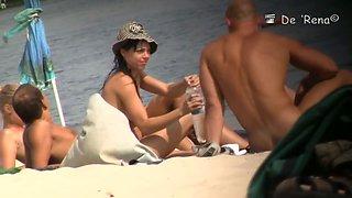 Mature bimbos get their panties in voyeur nudist beach video