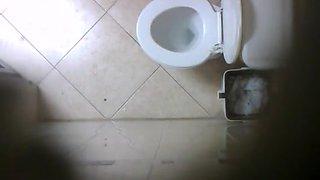 Cute teen caught peeing in toilet