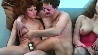Two classic white milfs on the couch having relaxing foursome