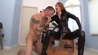 Mistress uses the strapon with the submissive slave