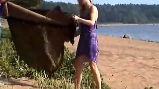 Naked blonde gives an amazing blowjob on the beach