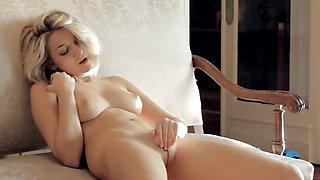 Beautiful busty glamour touching herself