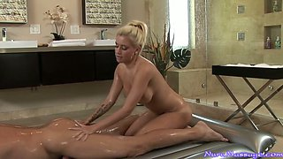 Oiled up buxom blonde Mariah Maddisyn sucks lucky dude off in massage parlor