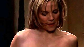 Kim Cattrall naked underneath a guy on a bed, the bed posts