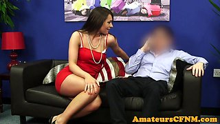 Classy CFNM babe cocksucking on the couch