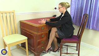Blonde secretary Abigail Toyne exposes her tits and plays with them