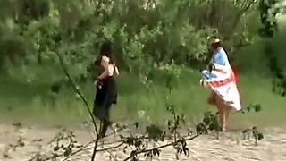 Women peeing in the grass and sand