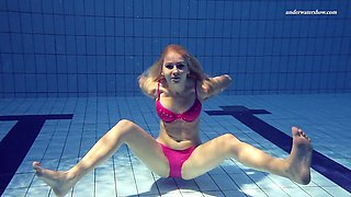Hot ass blonde teen perfecting her seductive teases in pool
