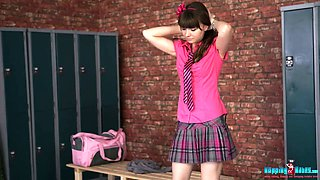 Cutie in pink college uniform is stripping in the locker room