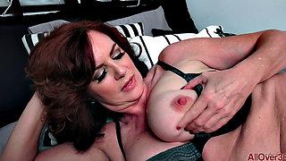 Mature brunette Andi James masturbating