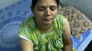 Mature and happy Indian aunty giving oily handjob on cam