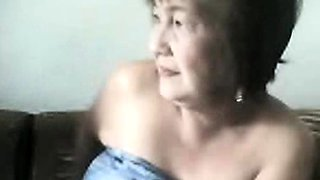 Fat Granny Asian lady on cam showing goods on cam