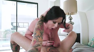Brunette milf with huge boobs gets banged by tattooed stud