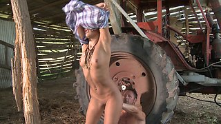 Sexy slut Honey Demon gets double-teamed in front of a tractor