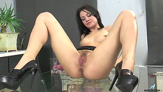 Svelte raven haired lady Magda brags off her wet pussy on glass table