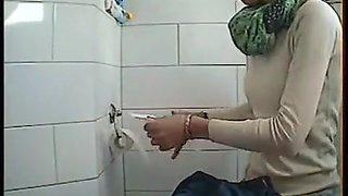 Skinny maid goes pee in toilet cam footage