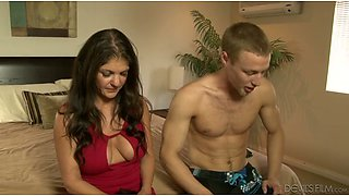 Gorgeous milf in red dress tries to seduce a young man