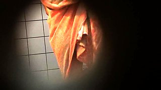 Shower voyeur spies on a sexy amateur babe with a lovely ass