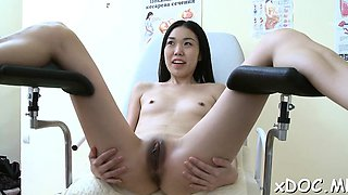 Hawt hottie is showing her bald pussy to her doctor