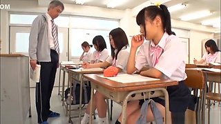 Horny Japanese schoolgirls fuck their teacher in the classroom