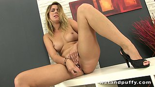 A hot pornstar gets busy with toys and fuck machines