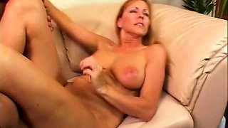 Bodacious blonde cougar gets drilled by a young black stud