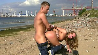 Russian beauty fucked on a public beach by his big dick