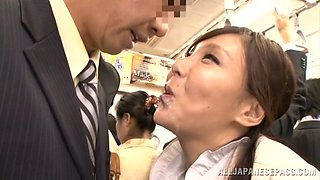 Japanese office girl gives a blowjob to some guy in a public place