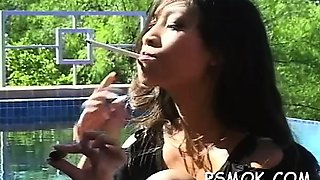 Sexy floozy in fishnet nylons teases whilst smoking