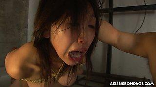 Kinky Asian dude fucks face of tied up and suspended hooker Kana Sato