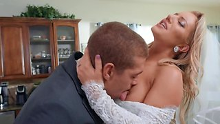 Whorish blonde bride in veil cheats on her groom in the kitchen