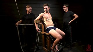 Mature well hung gay dude tied up and abused in a dungeon