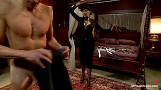 slave is dressed like a woman and fucked by her mistress