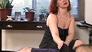 Brunette babe smoking while giving a handjob