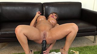 Big breasted cougar in heat Ava Devine buries a huge dildo in her ass