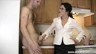 Amateur handjob and a blowjob in the kitchen by a mature wife