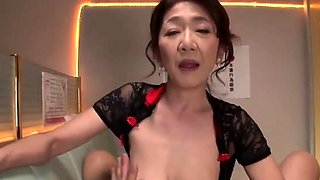 Mature Japanese lady with big tits knows what a cock needs