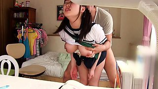 Pigtailed Asian schoolgirl learns a lesson in hardcore sex