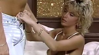 Naughty and horny blonde milf on the couch enjoys cunnilingus