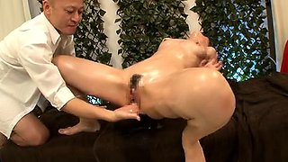 Slim Japanese babe has a masseur plowing her wet pussy