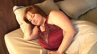Homemade clip with my redhead wife showing her tremendous boobs