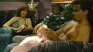 Ginger lesbians pleasing brunette girlfriend on a black sofa