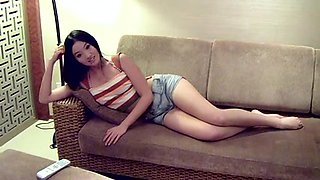 Clothes Chinese chick posing on the couch with passion