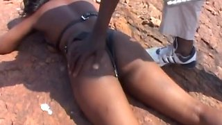 Obedient black girl in sexy leather outfit gets spanked and abused by her master