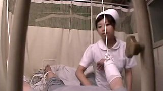 Asian nurse rides her patient's dick in spy cam sex video