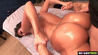 Stunning oiled up client Kelly Divine gets intimate with horny masseur