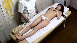 Alluring Japanese babe invites a masseur to fuck her pussy