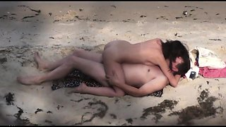 Exciting brunette takes a hard cock for a ride on the beach