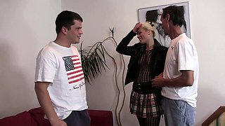 Old husband watching young blonde in fishnets riding