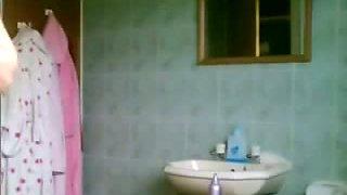 Hot blonde naked on a shower spy cam